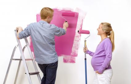 Couple painting nursery room