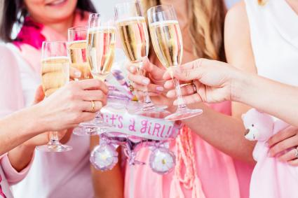 Women Toasting Wineglasses In Baby Shower