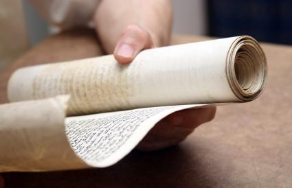 Holding an ancient scroll