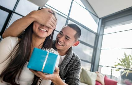 Man giving girlfriend a surprise gift