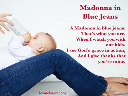 Baby lying on mother's legs wearing jeans and quote