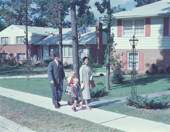 1950s family walking along a sidewalk