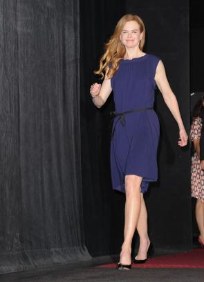 Nicole Kidman in a modern belted chemise-style dress
