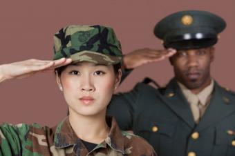 Female US Marine Corps soldier with male officer saluting