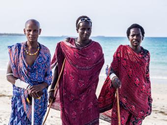 Modern Masai men in traditional clothing