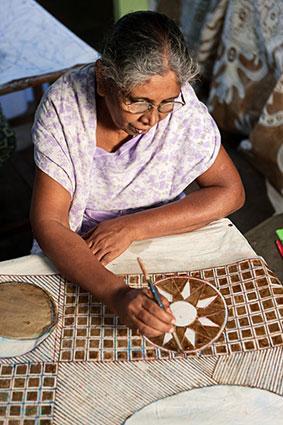 Sri Lankan woman making batik