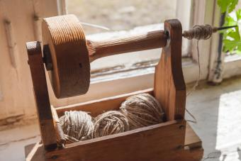 Ancient wooden tool for hand spinning
