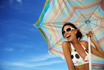 Woman holding beach umbrella