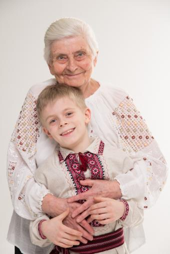 Grandmother and grandson with embroidered tops