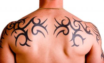 white guy with tribal tat