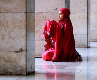 Woman praying in mosque
