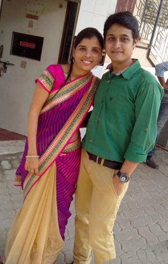 Woman in sari with husband
