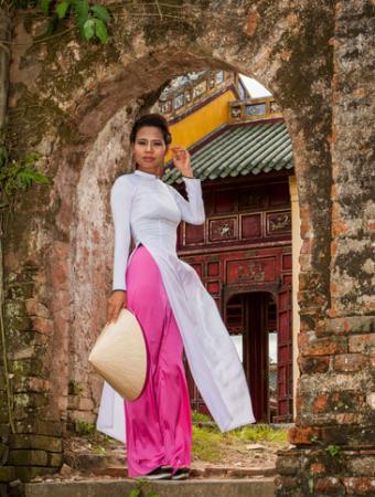 Woman wearing ao dai dress in Hue, Vietnam