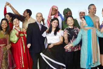 Multi-ethnic people in traditional dress dancing
