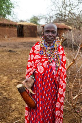 Maasai woman in traditional dress.
