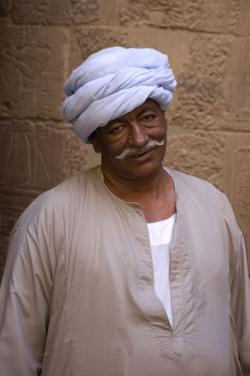 Egyptian man wearing turban and traditional Arab clothing