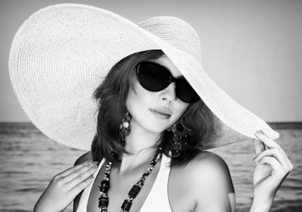 Woman wearing hat at beach