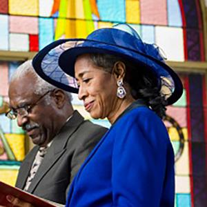 African American woman wearing hat at worship service