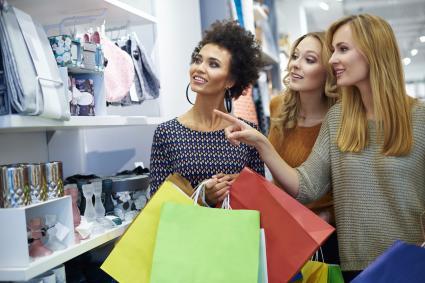 Three girls in a shop