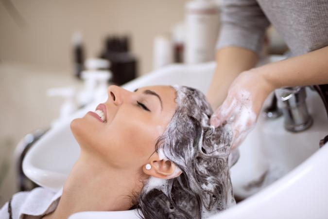 Shampooing hair in salon