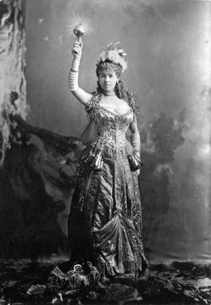 Mrs. Cornelius Vanderbilt aka Alice Claypoole Gwynne as 'Electric Light'. Gown created by Charles Frederick Worth.