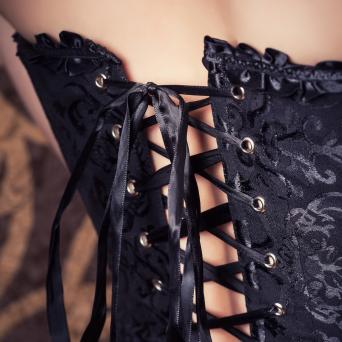 Woman wearing black corset