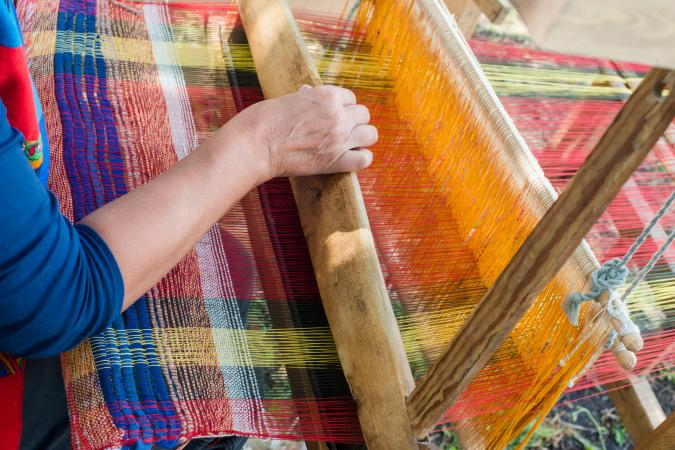 Weaving on a wooden loom