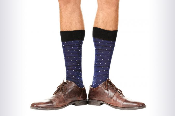 Man's legs in colorful socks