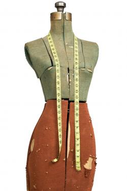 antique tape measure on mannequin