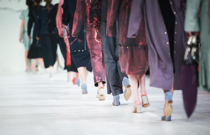 Fashion models walking down a runway