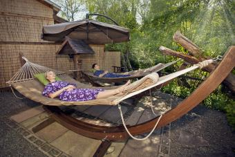 couple in hammocks in zen garden