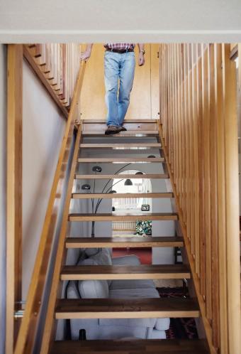 Man walking down wooden steps