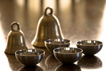Brass bells and silver bowls
