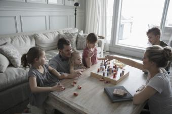 family playing game on coffee table