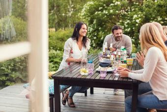 Friends socializing on wood deck