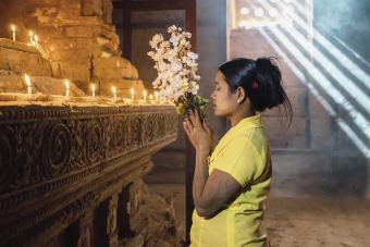 Burmese Woman Praying in Temple Stupa Bagan Myanmar