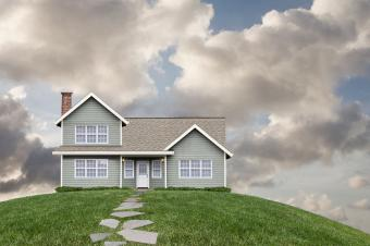 House on grassy hill