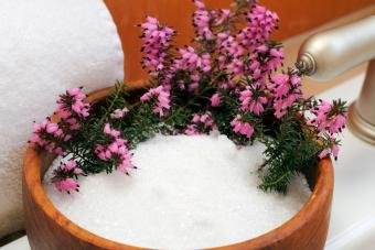 Epsom salt in bowl with heather