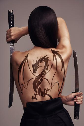 dragon tattoo on woman's back