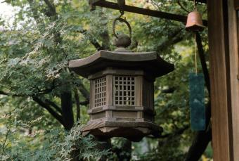 Lantern and wind chime hanging on porch