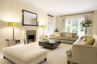 Large reception room in a luxury new home with two settees