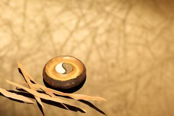 wooden yin yang with bamboo leaves
