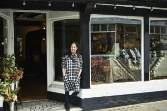 Retailer standing outside her boutique