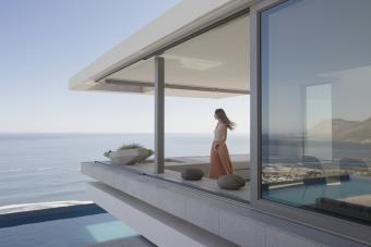 Woman standing on deck overlooking ocean