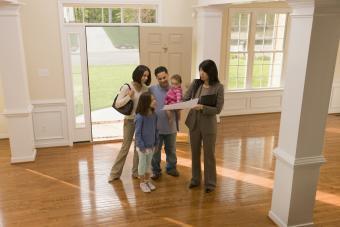 Family examining floor plan