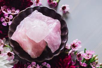 Rose quartz in bowl with flowers