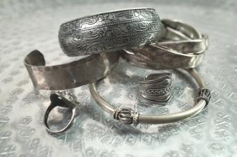 silver bracelets and rings