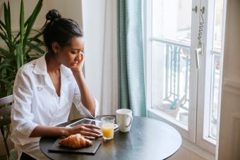 Woman sitting at dining table