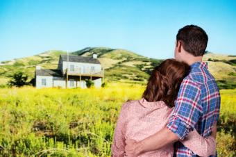 Couple looking at house in front of hills