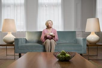 Woman on couch between lamps